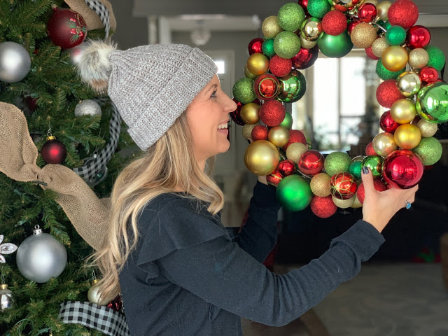 This DIY ornament wreath is easy and inexpensive to make.  Customize it with your favorite Christmas colors to create a one of a kind decoration!  Makes a great gift idea too.  See how at www.midwesternmama.com