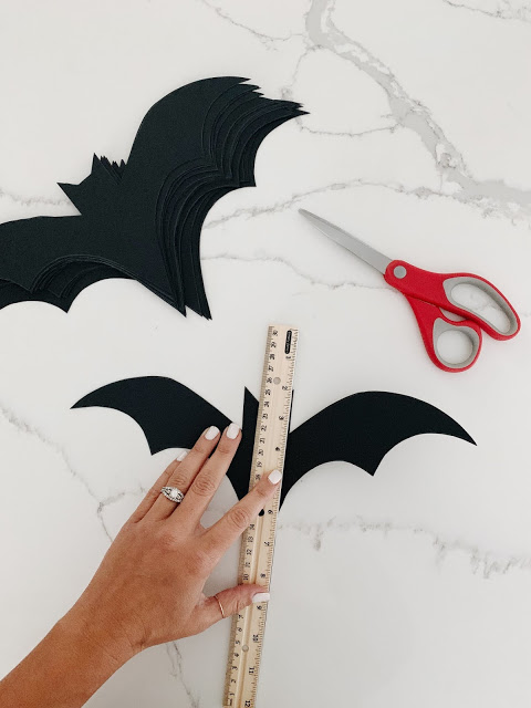 The EASIEST Halloween decorations ever!  These DIY bats are made from cardstock.  They are simple, spooky, and the perfect addition to your Halloween decor!  Midwesternmama.com  #halloween #decor #halloweenbats #halloweendecor #DIYdecor